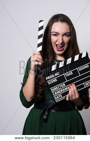 Screaming Young Woman Holding A Movie Clapper