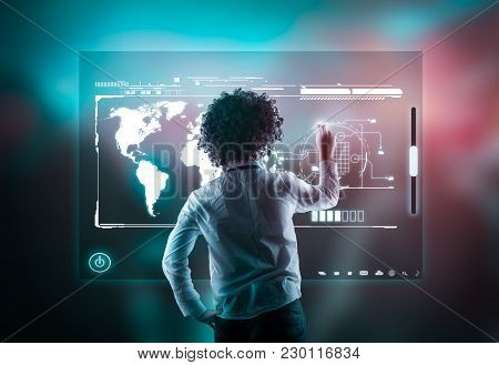 Man Using High Tech Screen On A Abstract Background With Bokeh Lights.
