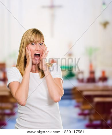 Portrait Of Shocked Woman at a church