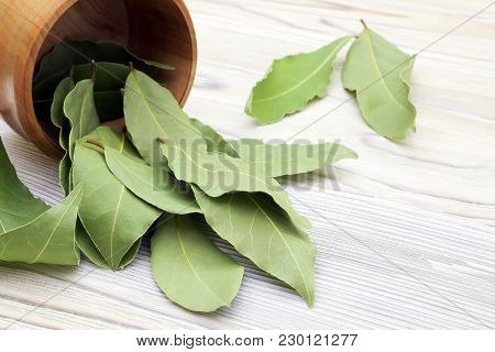 Dried Aromatic Bay Leaves In A Wooden Bowl On The White Wooden Rustic Table. Photo Of Laurel Bay Har