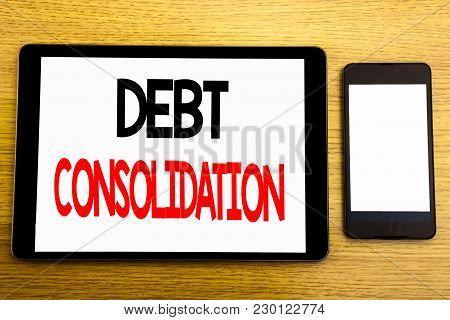 Writing Text Showing Debt Consolidation. Business Concept For Money Loan Credit Written On Tablet, W