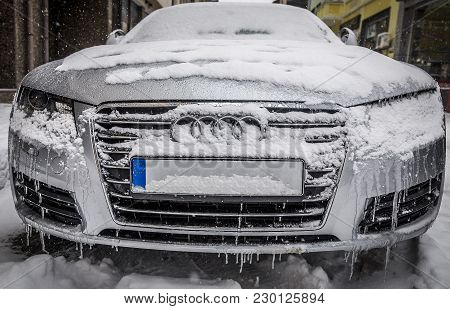 Frozen Car All In Ice And Snow Parked On A Street In The City. Editorial Use Only. Burgas/bulgaria/0