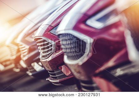 Automotive Industry Car Dealer Stock Closeup Photo. Modern Brand New Vehicles For Sale.