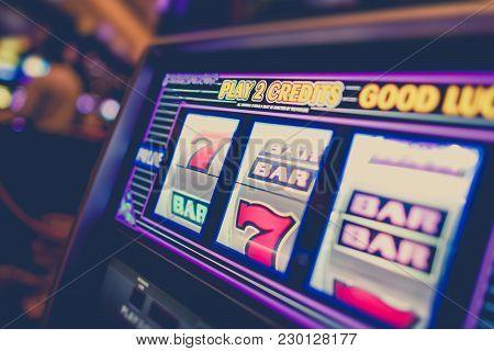 Casino Slot Machine Closeup Photo. Classic Las Vegas Style One Handed Bandit Slot Game.