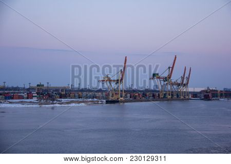 Freight shipping containers and gas oil tanks at the docks. in import export and business logistic.