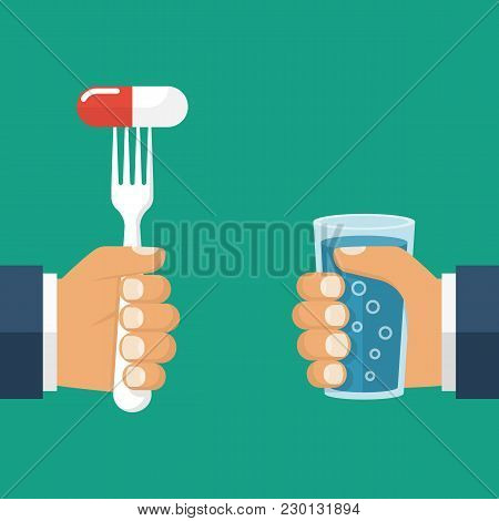 Eating Pills. Taking Tablet. Man Holding A Fork With The Capsule. In The Other Hand A Glass Of Water