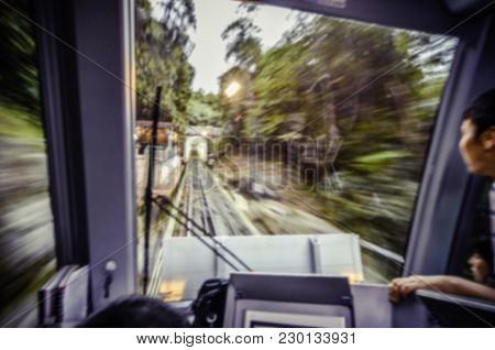 Blurred Motion Image From Train Driver Cockpit While Climbing The Hill. Green Tree And Foliage Along