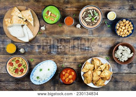 Various Dishes Of Pakistani And Bangladeshi Cuisine On A Wooden Table Banner. Copy Space. Concept: E