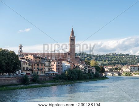 View Of Verona. Ponte Pietra, Once Known As The Pons Marmoreus. It Is The Roman Arch Bridge Crossing