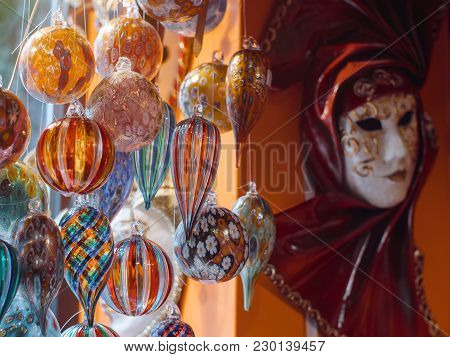 Colorful Souvenirs From The Famous Murano Glass. Venetian Masks In Store Display In Venice. Annual C