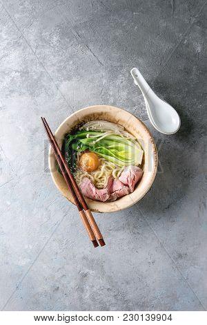 Asian Dish Udon Noodles With Egg Yolk, Sesame, Mushrooms, Boc Choy, Sliced Sous Vide Cooked Meat Ser