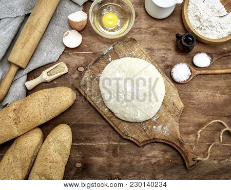 Yeast Dough Made From White Wheat On A Brown Wooden Board , Top View