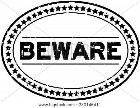 Grunge Black Beware Word Oval Rubber Seal Stamp On White Background