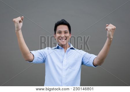 Asian Man Success Concept With Hands Up On Sky
