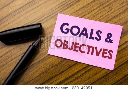 Word, Writing Goals Objectives. Business Concept For Plan Success Vision Written On Sticky Note Red