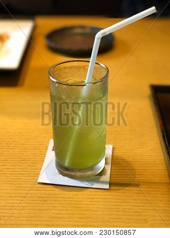 Ice Green Tea On Wooden Table In Restaurant