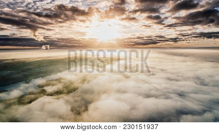 Riga City Autumn Drone Flight Above And Sunrise Above Clouds R Near Daugava River