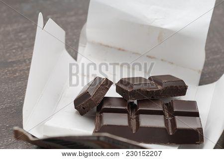 Open Carton Box With Dark Chocolate Bar