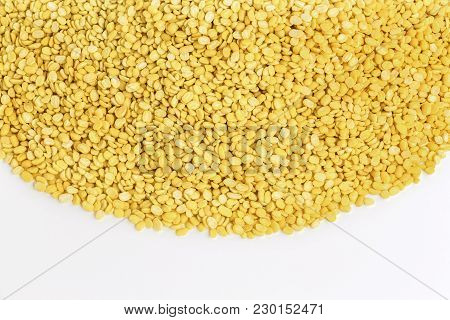 A Lot Of Yellow Split Mung Dal Or Moong Dal Pile Isolated On White Background With Copy Space For Te