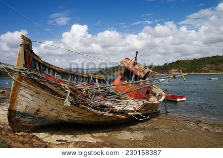 Fishing Boat Wrecked Into A Rocky River Bank