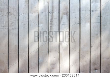 Background Texture Of Sheet Metal Panels With Sunbeams