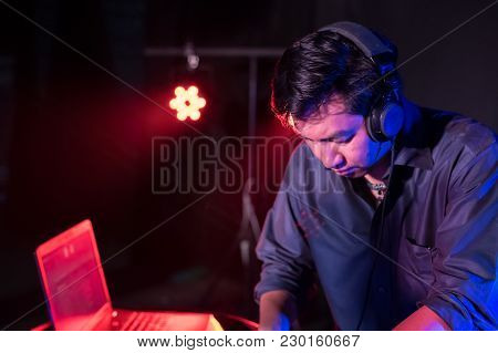 Music Concepts. Dj Is Rhythm Music With Controller And Mixer. Dj Is Playing The Song At The Party. Y