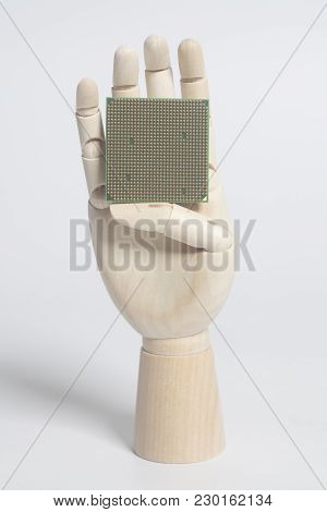 Wooden Robot Hand Holding Central Processing Unit Cpu Microchip On White