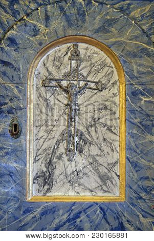 VELIKA MLAKA, CROATIA - MARCH 28: Cross, door of tabernacle on the altar in the Church of the Saint Barbara in Velika Mlaka, Croatia on March 28, 2017.
