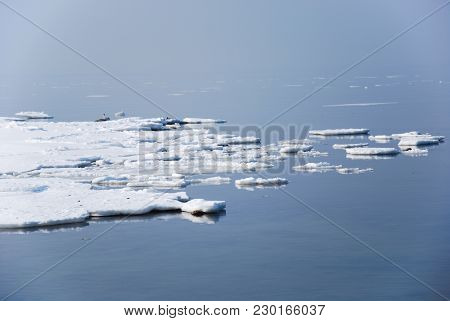 Springtime Scenery With Melting Ice By A Misty Coast