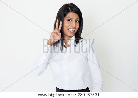 Closeup Portrait Of Smiling Young Lovely Indian Woman Looking At Camera And Showing Victory Sign. Vi