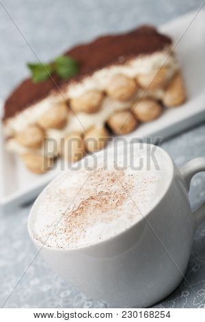 Closeup Of A Cappuccino With Tiramisu On A Table