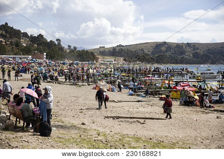Copacabana, Bolivia - January 6, 2018: Unindentified People On Lake Titicaca Shore In Copacabana, Bo