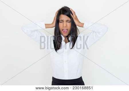 Closeup Portrait Of Shocked Young Pretty Woman Screaming And Clutching Head With Her Eyes Closed. Sh
