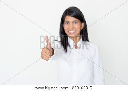 Closeup Portrait Of Smiling Young Beautiful Indian Woman Looking At Camera And Showing Thumb Up With