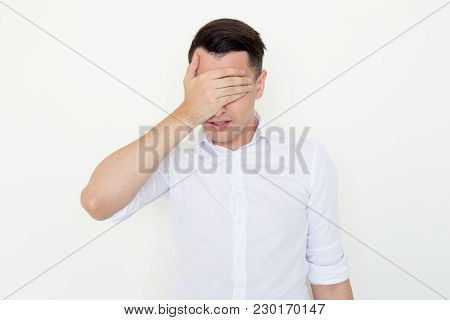 Closeup Of Young Man Covering Eyes With Hand. Depression Concept. Isolated Front View On White Backg