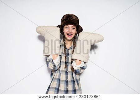 Beautiful Russian Woman Holding Felt Boots In Front Of White Background