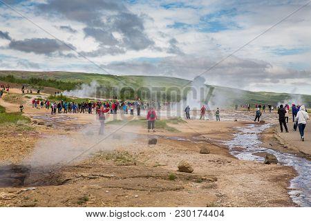 Reykholt, Iceland - June 24: People Wait For The Eruption Of The Reykholt Geyser On June 24, 2013 In