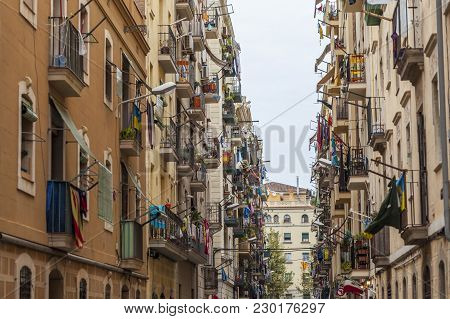 Barcelona,spain-september 29,2015: Narrow Street, Facade Houses, Barceloneta Quarter, Barcelona.