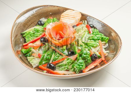 Dietary Salad Of Bell Pepper, Lettuce, Cucumber, Olives And Olive Oil, A Slice Of Bread. In The Midd