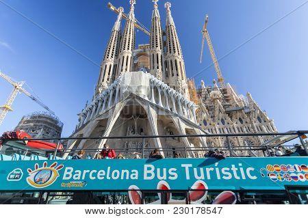 Barcelona, Spain- December 30,2015: Barcelona Bus Touristic Front Famous Sagrada Familia, By Antoni