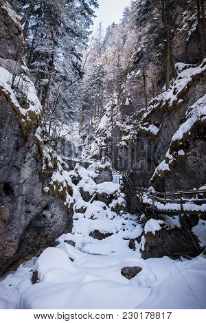 Frozen Icy Snow Covered Waterfall In Gorge Baerenschuetzklamm With Wodden Ladders And Bridges In Win
