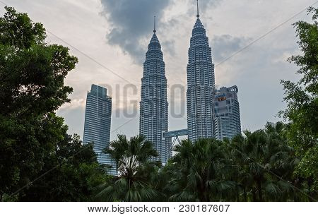 The Petronas Towers And Park At Sunset On August 29, 2012 In Kuala Lumpur, Malaysia.