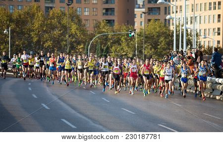 Valencia - November 18: Several Unidentified Runners Starting The Mens 10k At Start Line In Valencia