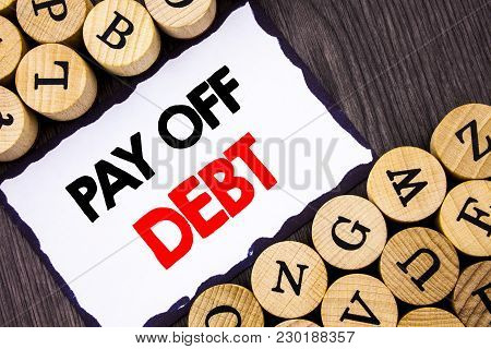 Handwritten Text Sign Showing Pay Off Debt. Business Concept For Reminder To Paying Owed Financial C