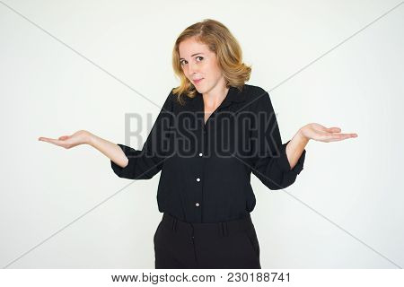 Misunderstanding Lady Shrugging Shoulders And Looking At Camera. Indifferent Businesswoman Expressin