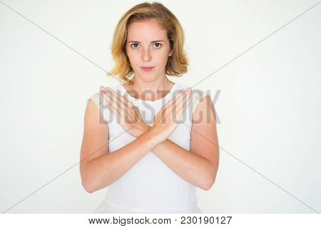 Serious Displeased Young Businesswoman Crossing Hands Showing Stop Gesture. Confident Lady Looking A