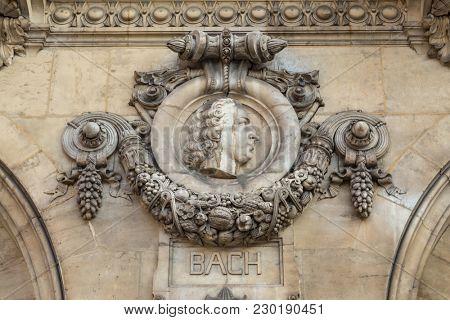 Architectural details of Opera National de Paris: Bach Facade sculpture. Grand Opera is famous neo-baroque building in Paris, France - UNESCO World Heritage Site.