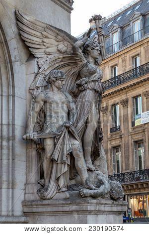 Architectural details of Opera National de Paris: Dance Facade sculpture by Carpeaux. Grand Opera Garnier Palace is famous neo-baroque building in Paris, France - UNESCO World Heritage Site