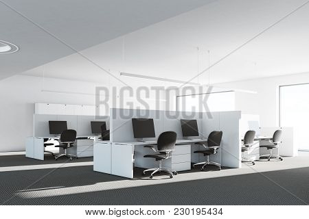 Cubicle Office Interior With White Walls, White Desks, Computers And Original Ceiling Lamps. A Corne