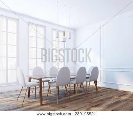 Modern Boardroom Interior With White Walls, A Wooden Floor, A Long Table With White Chairs And Large